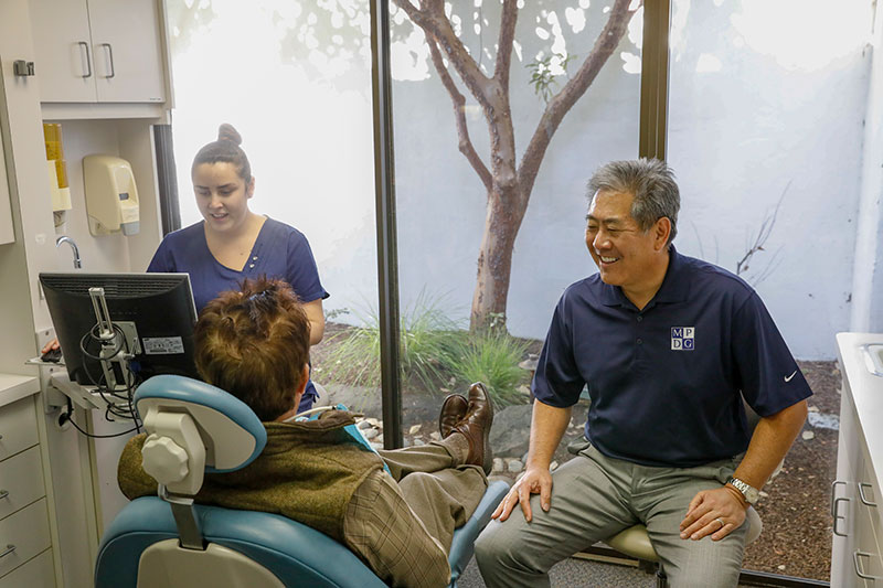 Dr. Ikemiya speaking with a patient at Monterey Peninsula Dental Group