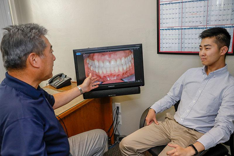 Dr. Ikemiya treating a patient at Monterey Peninsula Dental Group